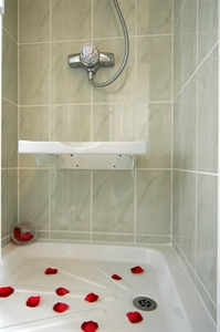 Drop down shower seat in white