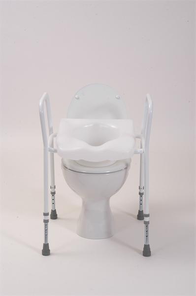 white toilet raised seat over a toilet