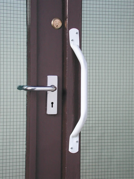 white grab rail attached next to door