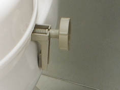 grey adjustment screw bracket for raised toilet seat
