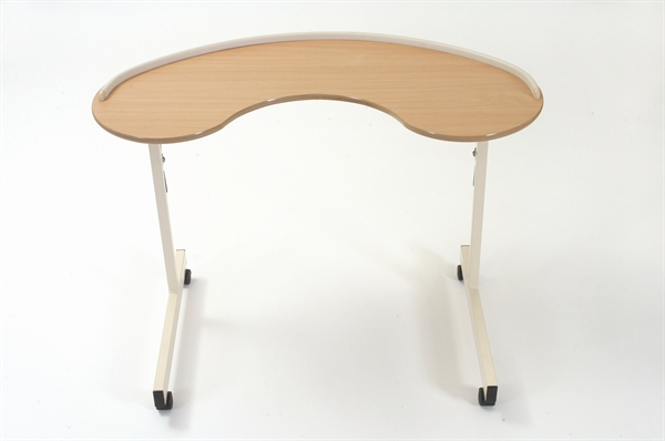 Kidney table from Cefndy Healthcare UK. The table allows the user to rest arms and have a large work surface.