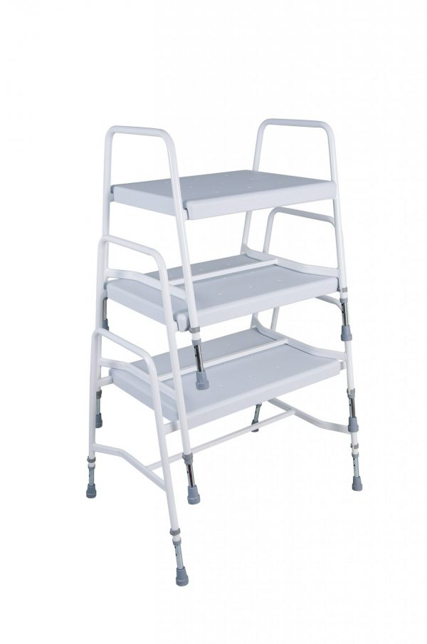 Stack of white shower stools